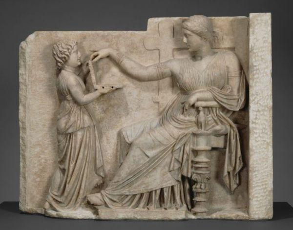 Ancient Greek Sculpture Shows a Woman Using a Laptop Computer