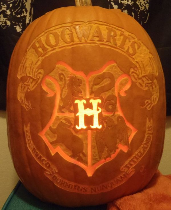 in celebration of her 100th pumpkin she went ahead and carved this amazing version of the hogwarts school crest that would fit right in - Hogwarts Halloween
