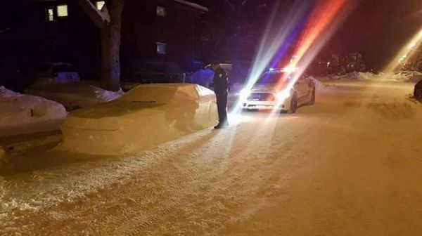 Prankster Fools Cops With Car Made Out Of Snow
