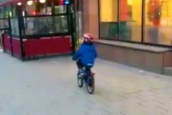 Little Boy Crashes His Bike After Being Distracted By Racy Strip Club Ad