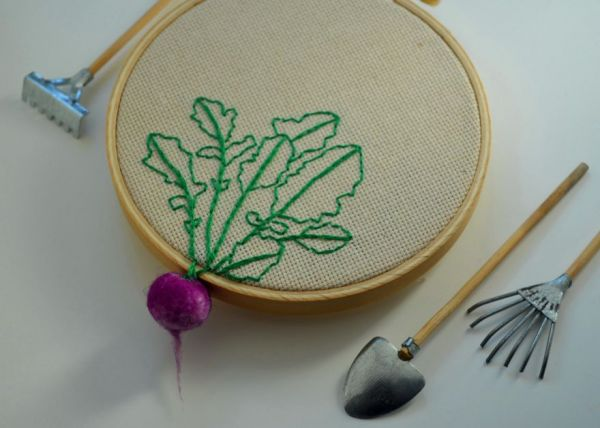 Felted vegetables hang from cross stitch hoops neatorama