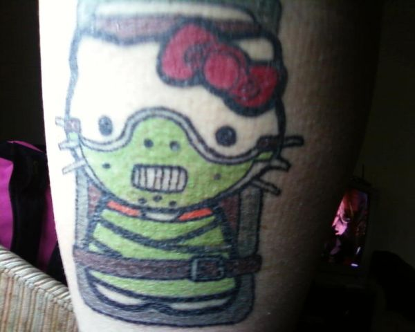 15 Utterly Bizarre Hello Kitty Tattoos 019effa124d47