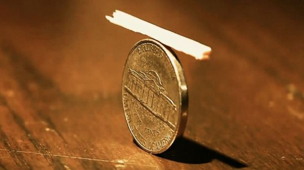 Remove A Matchstick Balanced On A Nickel Under Glass Without Touching Anything