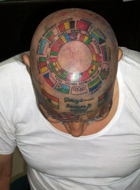 Guinness Rishi of India has covered his body with tattoos of 220 flags.