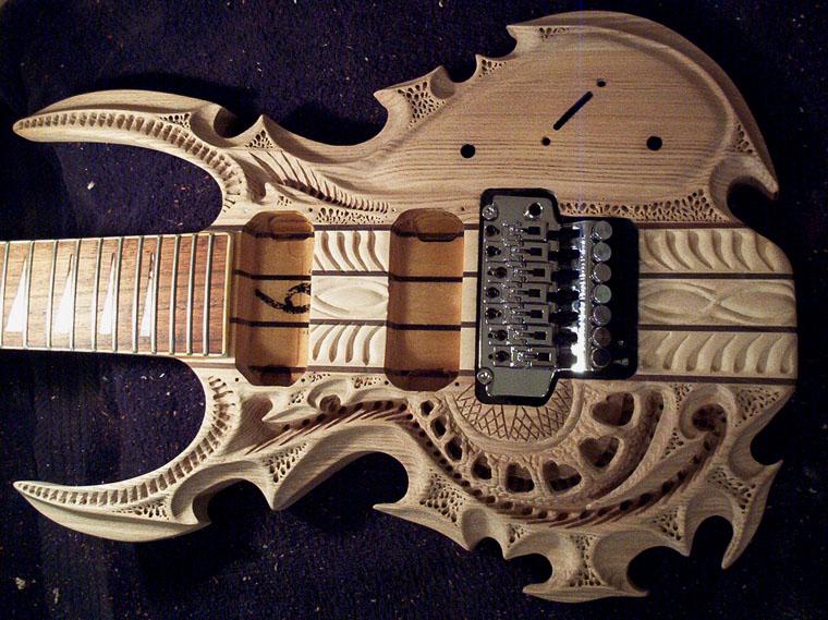 carved guitar body neatorama. Black Bedroom Furniture Sets. Home Design Ideas