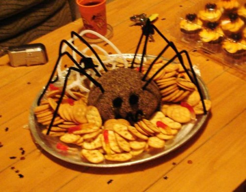 this one may not be as spooky as the rest but this cute spider cheese ball is a good way to sneak a traditional party favorite in - Scary Halloween Meatballs