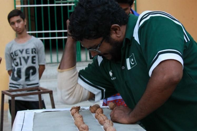 Man Breaks 256 Walnuts Using His Elbow