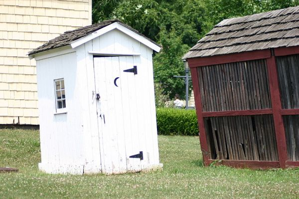 Why Do Outhouses Have a Crescent Moon on the Door?